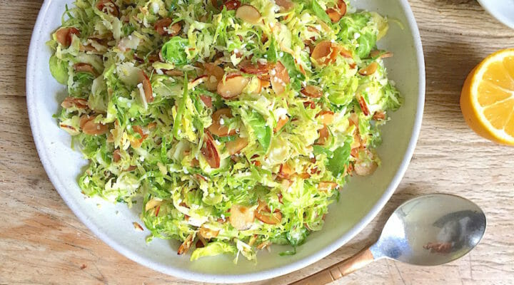 Shaves Brussels Sprouts Salad with Almonds in a Bowl