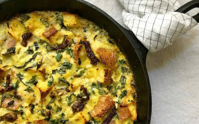 Egg and spinach strata in a cast iron skillet