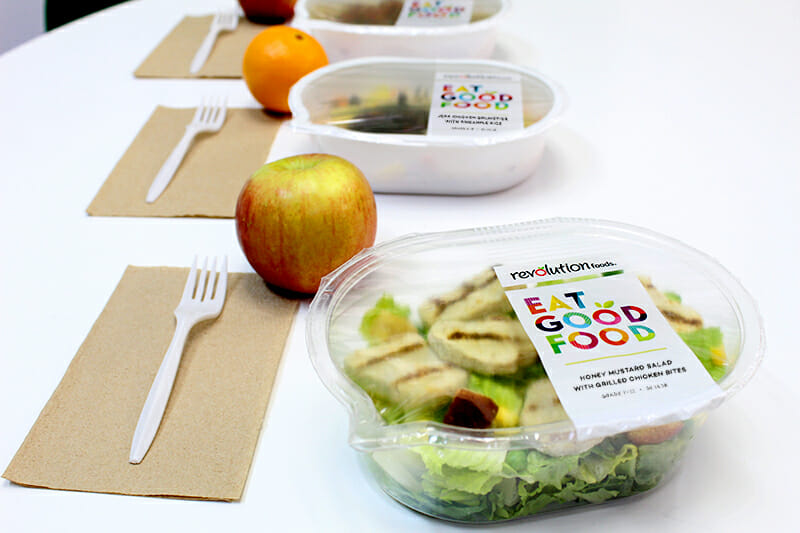 school lunch salad in container with apple